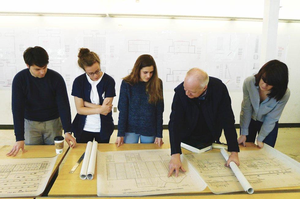 Prof. Robert Jan van Pelt reviewing                          blueprints for The Evidence Room.jpg