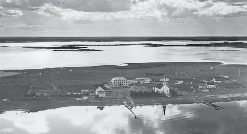 The Roman Catholic mission and residential school in Beauval, Saskatchewan. Deschâtelets Archives..png