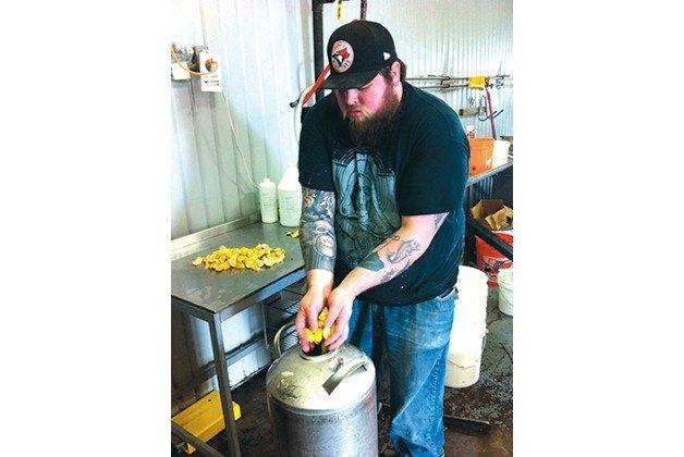 Bar Hop's Matt Bod prepares guavas at Great Lakes Brewery for Gilligan Is Still Dead.