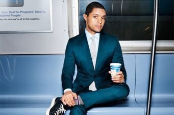 "alt=""A press photo of Daily Show host Trevor Noah"""