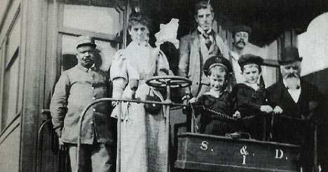 A black porter with passengers on Canadian Pacific Transcontinental in the 1890s.