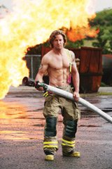 """Pin-up firefighter Joe signs autographs and puts the """"hot"""" in Harbourfront's Hot And Spicy Food Festival."""