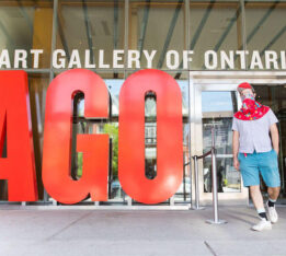 A photo of a masked visitor leaving reopened Art Gallery of Ontario on July 2, 2020.