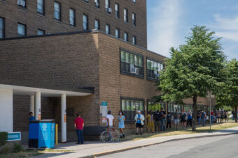 A photo of people lining up outside a COVID-19 assessment centre at St. Joseph's Health Centre on July 15, 2020.