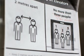 Sign depicting coronavirus social distancing practices in an elevator in Toronto, Ontario.