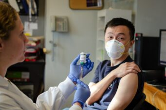 A photo of a person receiving a vaccine
