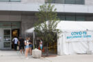 People wait outside a coronavirus testing centre in Toronto.