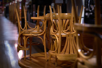 Restaurant chairs stacked on a table.