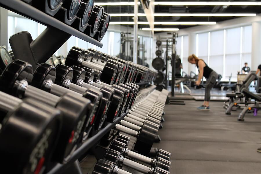 A photo of a gym with barbells