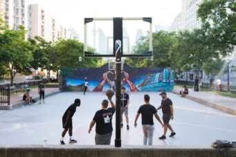 A photo of people playing basketball in Toronto
