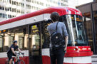 A photo of a cyclist passing a TTC streetcar during the COVID-19 pandemic on July 17.