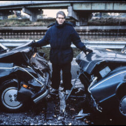 A photo of David Cronenberg on the Toronto set of Crash.