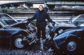 A photo of David Cronenberg on the Toronto set of Crash.