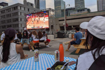 A photo of people watching a Raptors game in Toronto at Rendezviews.
