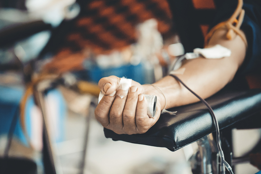 The arm of a person donating bloog.