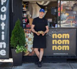Nom Nom Nom crepes owner Marc Perreault poses outside his stall at Market 707. a beloved source for Toronto street food.
