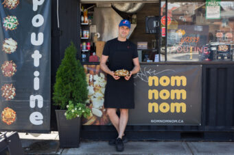 Nom Nom Nom crepes owner Marc Perreault poses outside his stall at Market 707. a beloved source for Toronto street food.