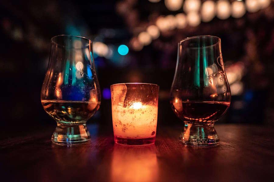A photo of Scotch in glasses at a bar
