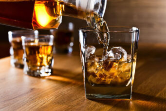 A photo of whiskey being poured.