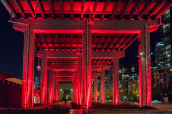 A photo of the Bentway lit up red
