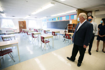 A photo of Doug Ford visiting Kensington Community School in Toronto
