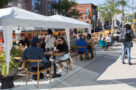 A photo of diners on a patio on Ossington in Toronto
