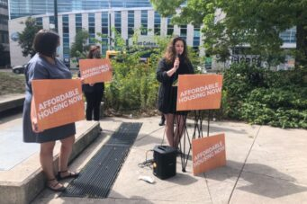 A photo of Caitlin Gowans speaking at MPP Jessica Bell's announcement of her Stop Illegal Evictions bill
