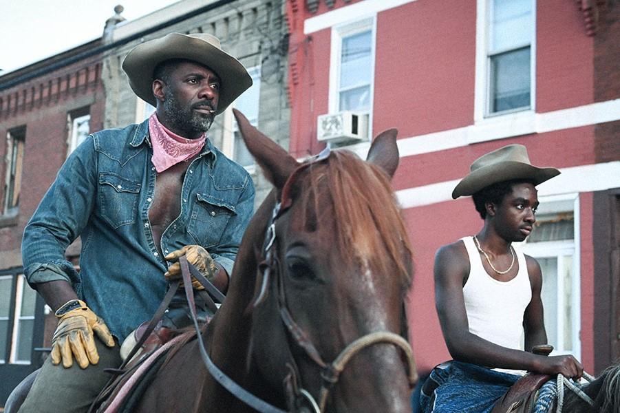 Idris Elba and Caleb McLaughlin hit the road in Concrete Cowboy.