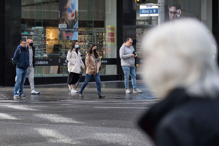 A photo of people wearing masks during the COVID-19 pandemic in Toronto.