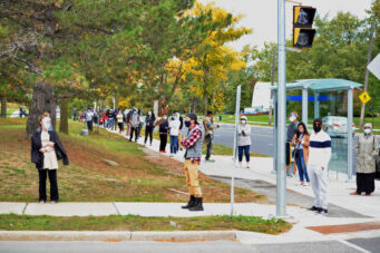 People wait in line for a COVID-19 test at the Birchmount COVID-19 Assessment Centre at 3030 Birchmount Road in Scarborough.