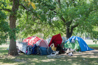 A photo of an encampment in Trinity Bellwoods Park in Toronto in August 2020