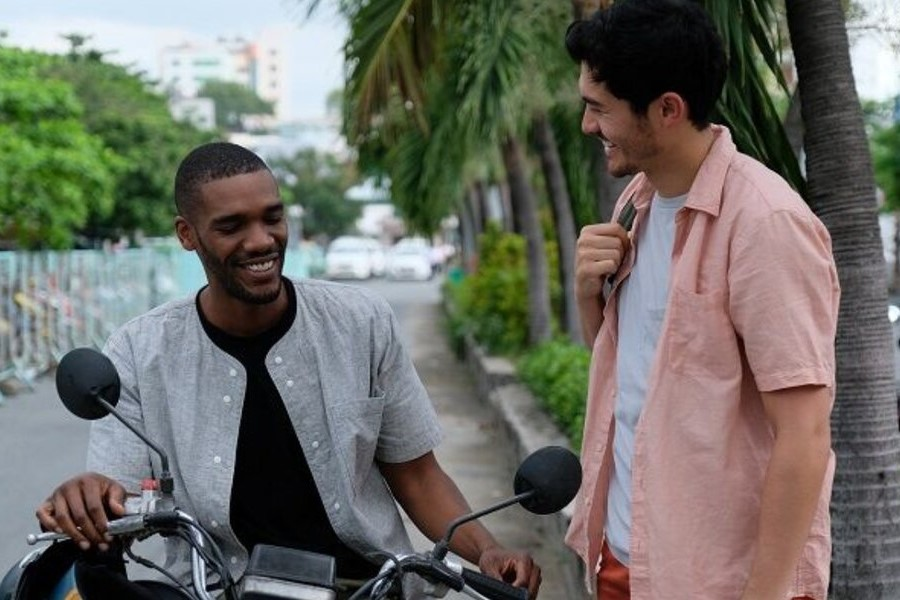 Parker Sawyers and Henry Golding connect in Monsoon.