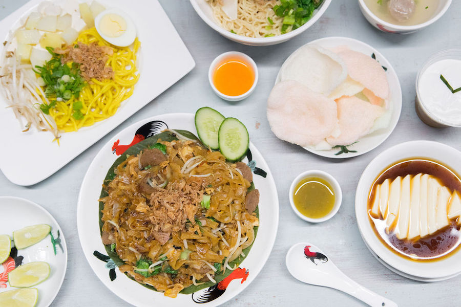 A photo of kwetiau goreng and tofu pudding at NaiNai Noodles Indonesian restaurant in Toronto