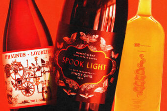 A photo of three orange wines