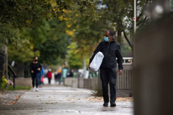 A photo of a person wearing a mask in Toronto in October 2020