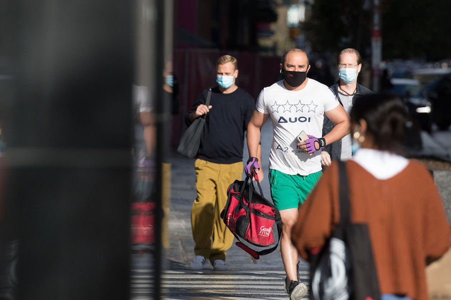 A photo of a man jogging in a face mask in Toronto in October 2020