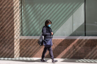 A photo of a pedestrian wearing a mask in Toronto in October 2020