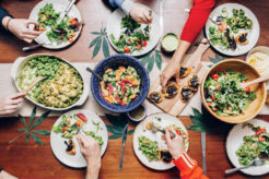 A photo of people eating a cannabis-infused dinner
