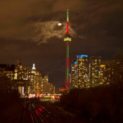 A photo of the CN Tower at night lit up