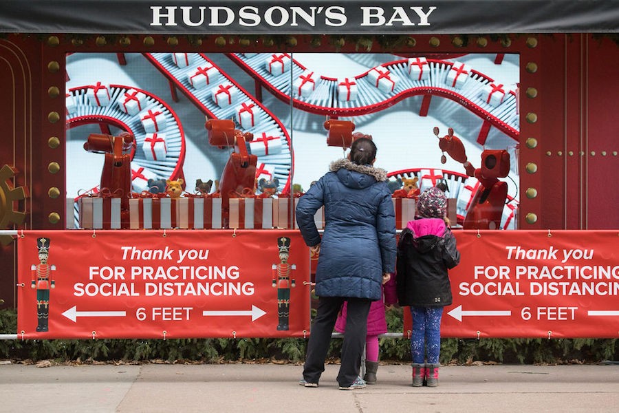 A photo of people looking at Hudson's Bay holiday windows during COVID-19 pandemic