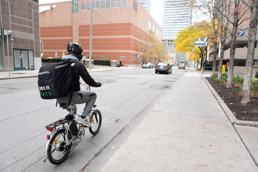 A photo of an Uber Eats takeout person in Toronto