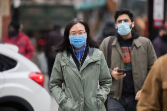 People wearing face masks in Toronto during COVID-19 pandemic