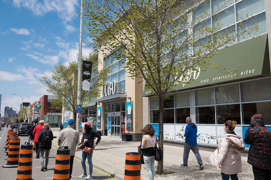 People wait in line outside the LCBO in May.