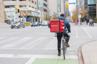 A photo of a DoorDash bike delivery person in Toronto