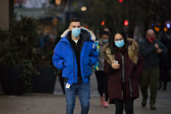 A photo of people wearing masks in Toronto during the COVID-19 pandemic on November 27, 2020.