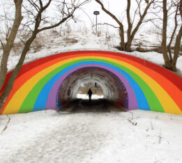 A photo of the pedestrian rainbow tunnel in Moccasin Trail Park, which cuts through a Toronto ravine
