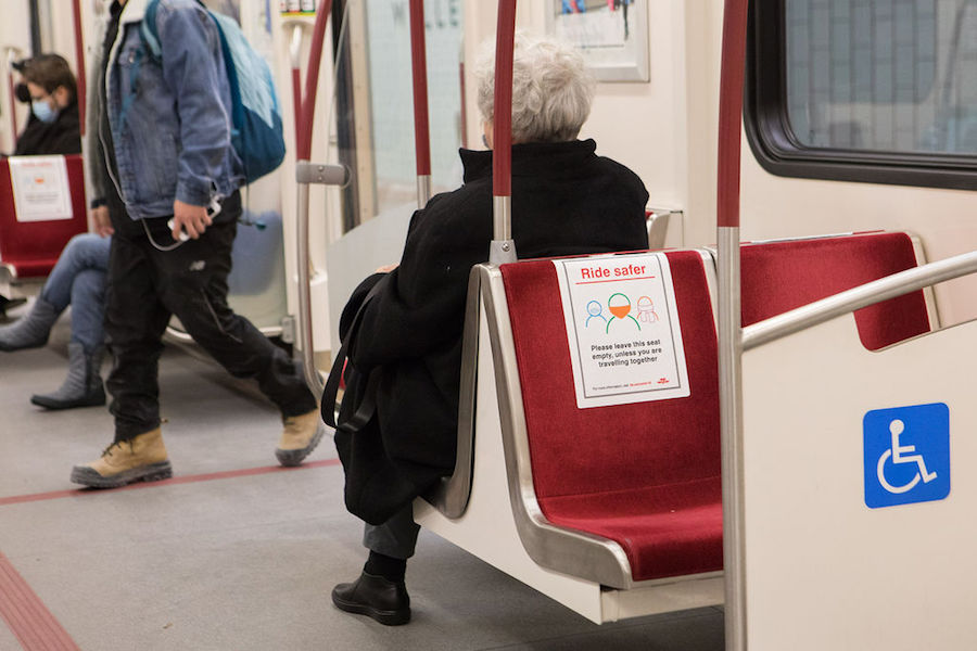 A photo of a TTC rider in Toronto during the COVID-19 pandemic in December 2020