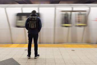 A photo of a TTC subway passenger waiting during the COVID-19 pandemic in Toronto