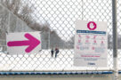 A photo of COVID-19 signs at a skating rink in Toronto