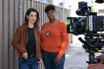 An image of Meredith MacNeill and Adrienne C. Moore on the set of Pretty Hard Cases.